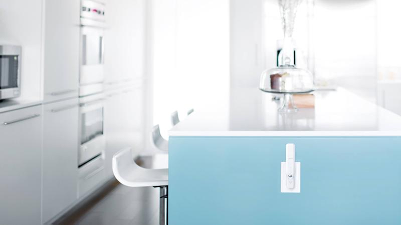 Ubiquiti Networks wireless hardware plugged into an electrical outlet in a contemporary kitchen.