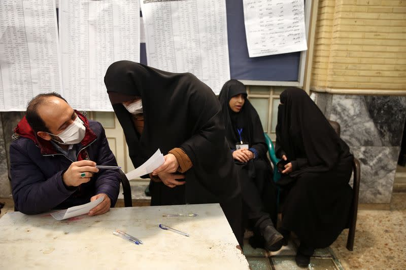 Iranian man casts his vote during parliamentary elections at a polling station in Tehran