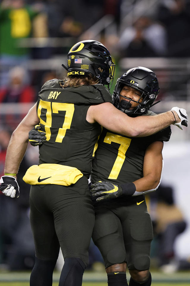 Oregon running back CJ Verdell (7) celebrates with Ryan Bay (87) after scoring a touchdown against Utah during the first half of the Pac-12 Conference championship NCAA college football game in Santa Clara, Calif., Friday, Dec. 6, 2018. (AP Photo/Tony Avelar)