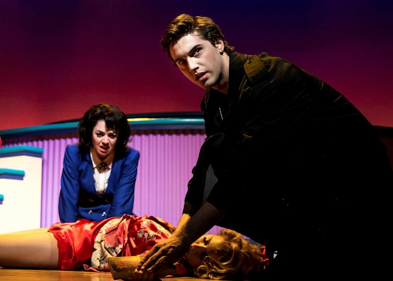 """This image released by Vivacity Media Group shows Barrett Wilbert Weed, left, and Ryan McCartan in a scene from the musical """"Heathers"""" performing at New World Stages in New York. (AP Photo/Vivacity Media Group, Chad Batka)"""