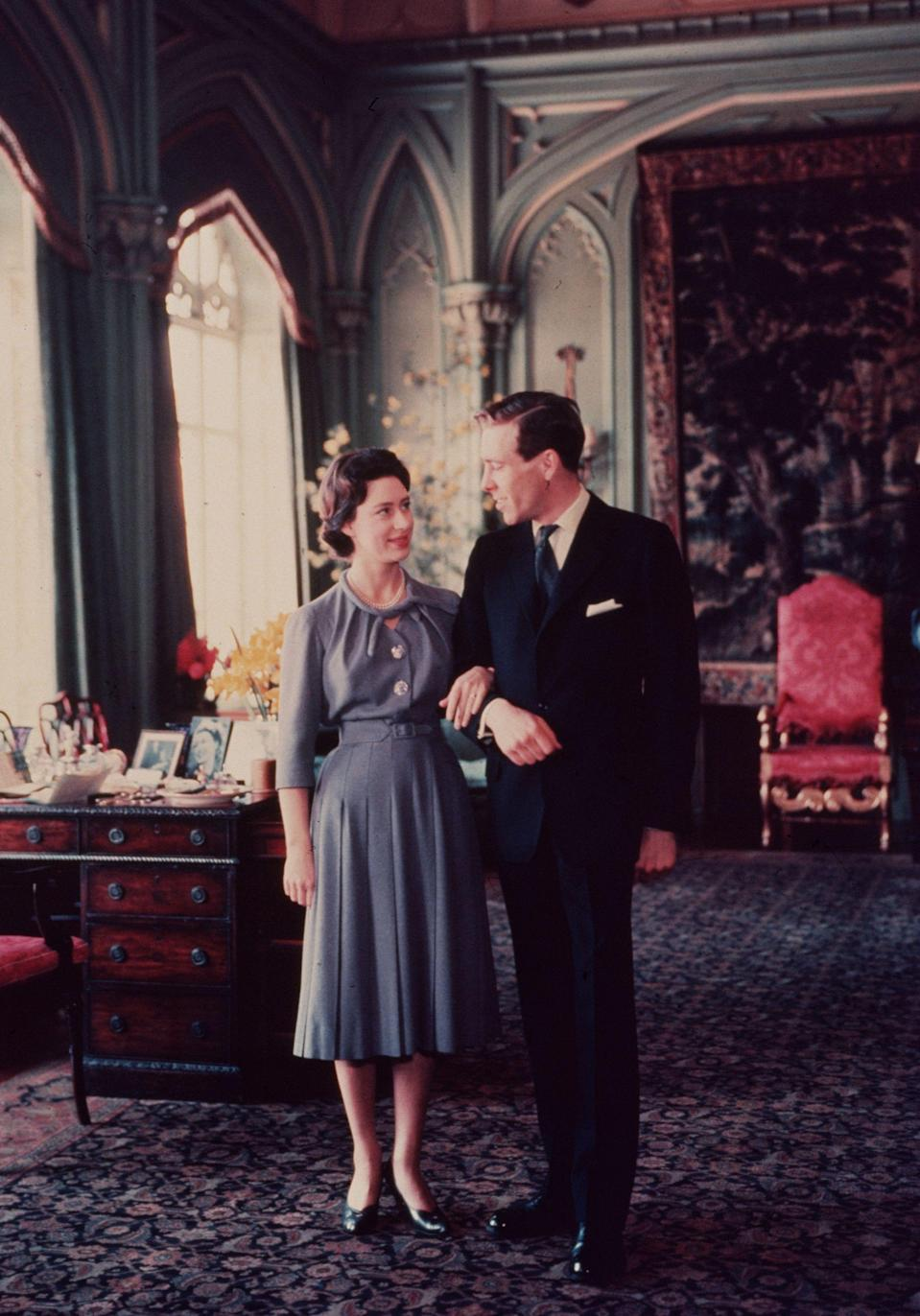 <p>Princess Margaret's engagement to photographer Antony Armstrong-Jones took the media circuit by surprise as she had worked hard to keep the romance under wraps.<br>After her first engagement to Peter Townsend was rejected by the Church of England due to his previous divorce, the princess accepted a proposal from Lord Snowdon.<br><br>The couple announced their engagement on 26 February 1960 and their nuptials were the first to be broadcast on television drawing in over 300 million viewers worldwide. Her engagement ring featured a rosebud-shaped ruby designed to honour her middle name, Rose. <em>[Photo: Getty]</em> </p>