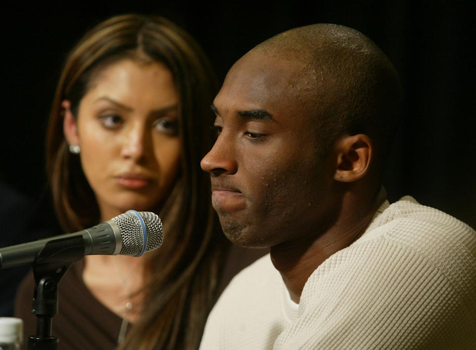 """On the same day he was charged with sexually assaulting a 19-year-old woman at a hotel in Eagle, Colorado, Kobe Bryant appeared with his wife Vanessa before the media, publicly denying any wrongdoing beyond """"making a mistake of adultery."""" (J. Emilio Flores/Getty Images)"""