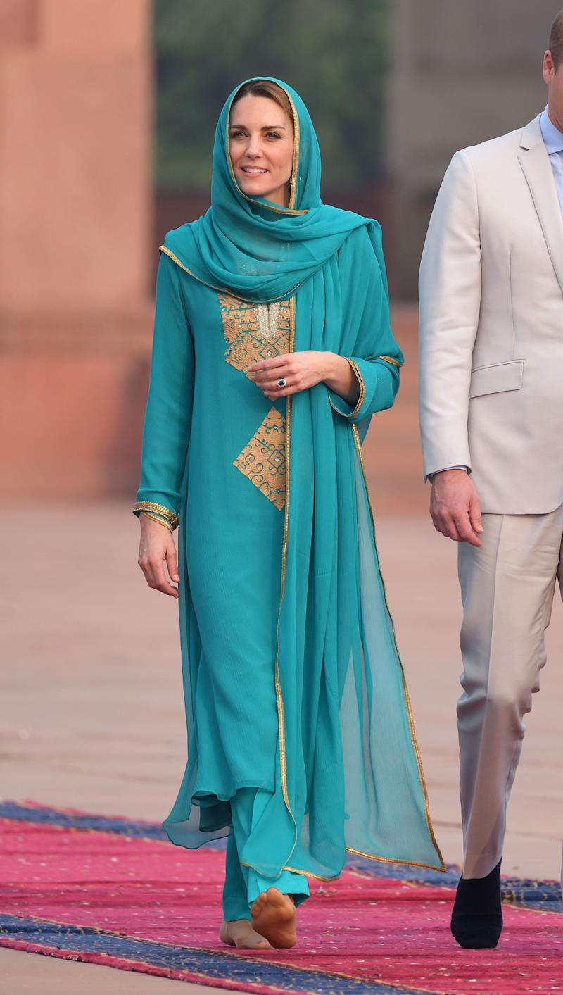 In traditional Pakistani dress while in Islamabad during a royal tour of Pakistan.