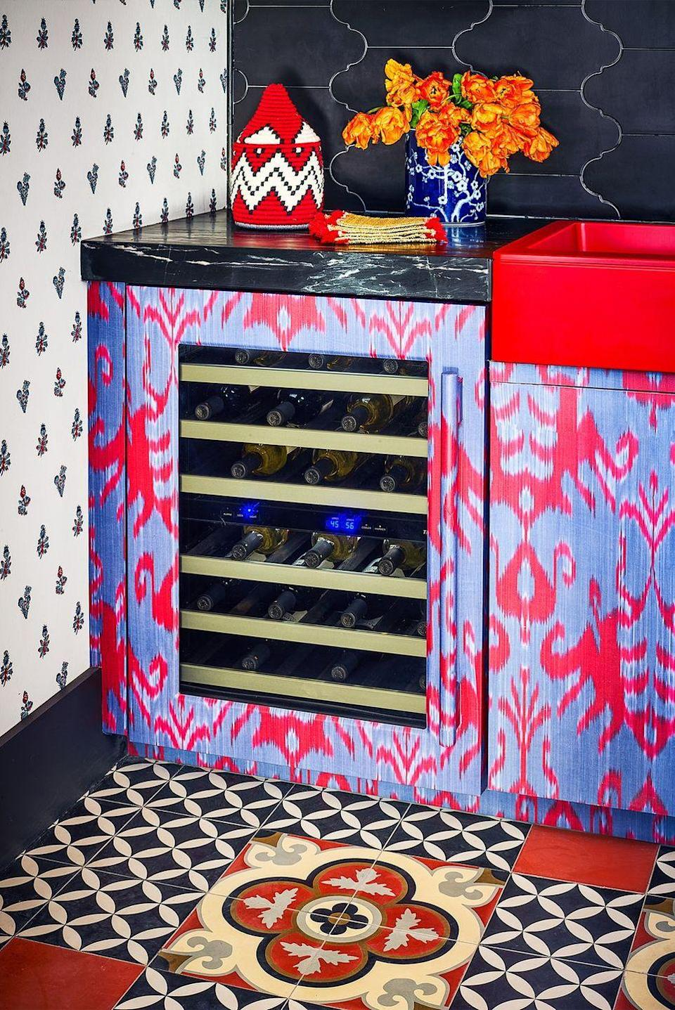 <p>Match your mini wine fridge to your cabinets. Michelle Nussbaumer chose her own purple and red ikat print for a romantic pop.</p>