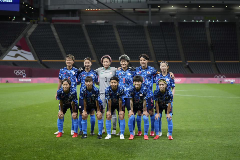 Japan's players pose for a team photo prior during a women's soccer match against Canada at the 2020 Summer Olympics, Wednesday, July 21, 2021, in Sapporo, Japan. (AP Photo/Silvia Izquierdo)