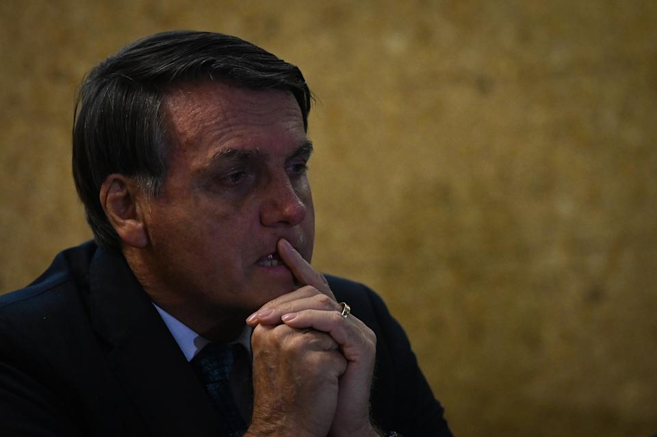 """BRASILIA, BRAZIL - SEPTEMBER 28: Jair Bolsonaro, President of Brazil looks on during the launch ceremony of the """"Mineracao e Desenvolvimento"""" Program on September 28, 2020 in Brasilia, Brazil. The program presents more than a hundred goals and actions for up to 2023 and aims at the quantitative and qualitative expansion of the Brazilian mineral sector and the image of mining with society. (Photo by Andre Borges/Getty Images)"""