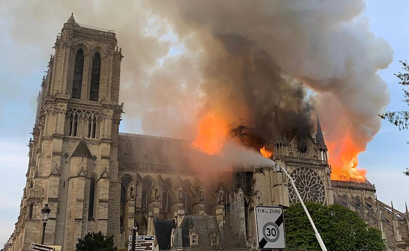 Flames and smoke are seen billowing from the roof at Notre-Dame Cathedral in Paris on April 15, 2019. (Photo: Patrick Anidjar/AFP/Getty Images)