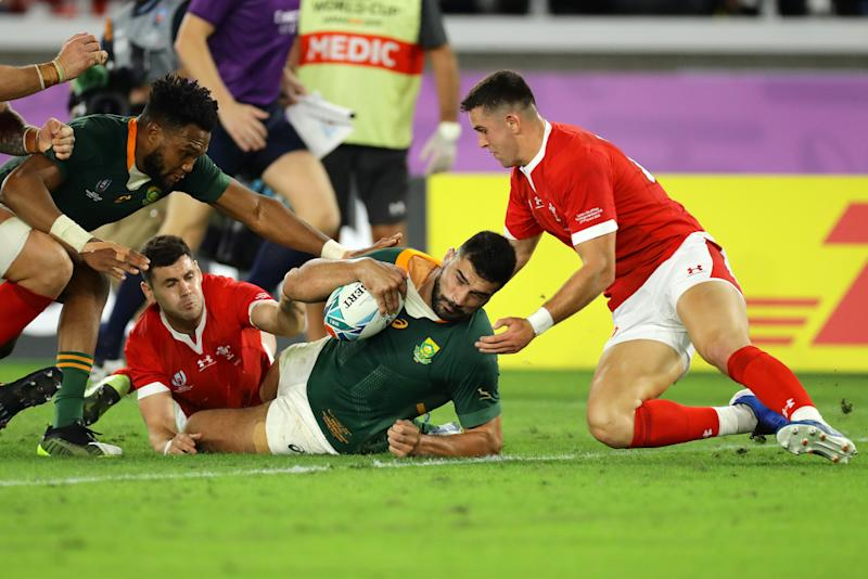 Damian de Allende of South Africa goes over to score his team's first try. (Credit: Getty Images)