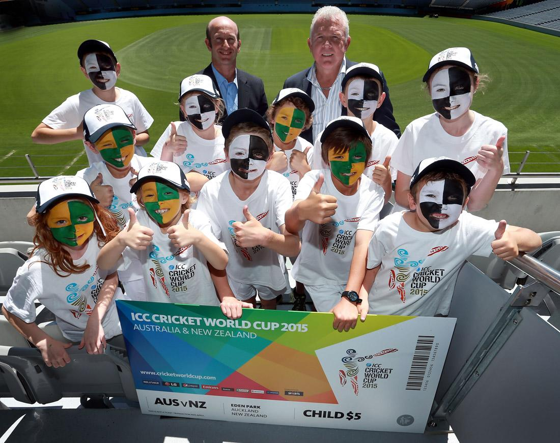 Chris Harris (L) and Craig McDermott pose with children and a mock ticket during the ICC Cricket World Cup 2015 Ticket pricing announcement at Eden Park on November 13, 2013 in Auckland, New Zealand.  (Photo by Simon Watts/Getty Images)
