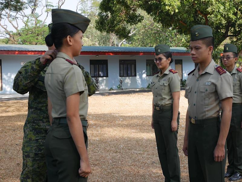 A cadet receives an award at an ROTC class in UP Diliman. Photo: Rachel Malaguit