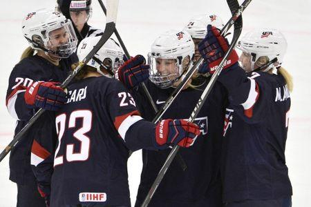 Jocelyne Lamoureux (C) of the U.S. celebrates her 1-0 goal with teammates during the 2015 IIHF Ice Hockey Women's World Championship group A match against Canada at the Malmo Isstadion in Malmo, southern Sweden, March 28, 2015. REUTERS/Claudio Bresciani/TT News Agency