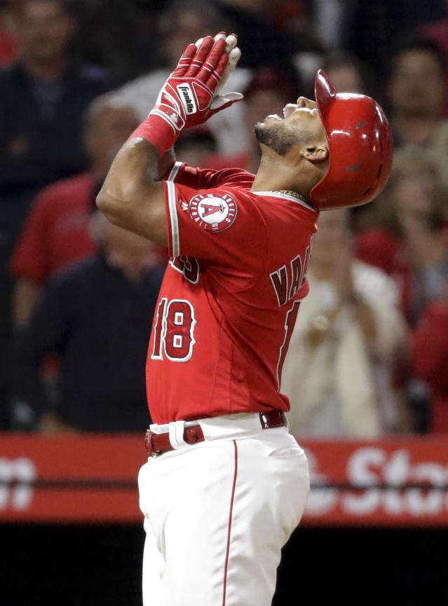 Los Angeles Angels' Luis Valbuena celebrates his home run against the Toronto Blue Jays during the eighth inning of a baseball game in Anaheim, Calif., Saturday, June 23, 2018. (AP Photo/Chris Carlson)