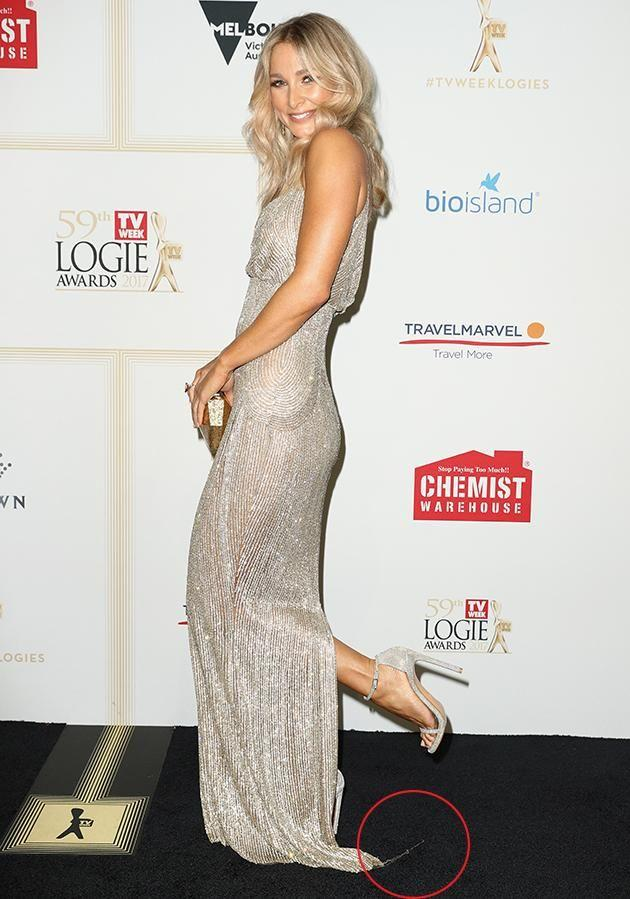 Bachelor stunner Anna Heinrich's Steven Khalil gown seemed to be unraveling on the red carpet last night. Photo: Getty