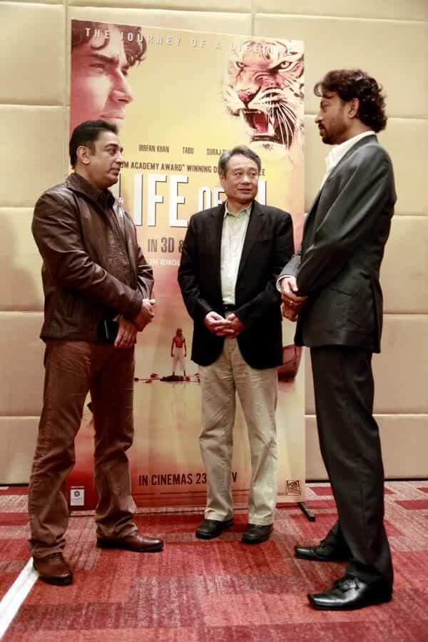 'Life of Pi' director Ang Lee and Kamal Hassan chat with Irrfan Khan during movie promotions.
