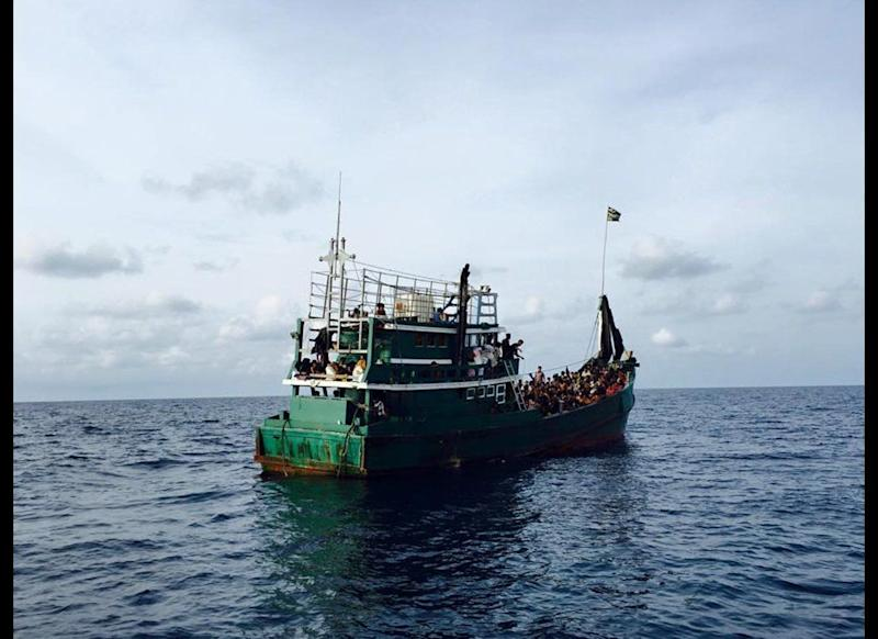 """A lost boat found carrying Rohingya refugees and Bangladeshi migrants in the Andaman Sea. The Rohingya people are fleeing Myanmar due to persecution and are not considered citizens by the Myanmar government. Pope Francis recently said, """"Hospitality in itself isn't enough. It's not enough to give a sandwich if isn't accompanied by the possibility of learning to stand on one's own feet. Charity that does not change the situation of the poor isn't enough."""" (Thapanee Letsrichai)"""