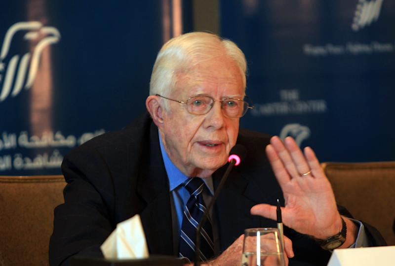 Former US President Jimmy Carter speaks during a press conference in Cairo on May 26, 2012