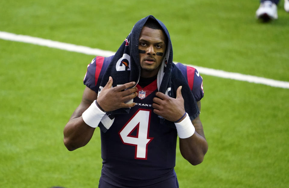 FILE - In this Jan. 3, 2021, file photo, Houston Texans quarterback Deshaun Watson walks off the field before the team's NFL football game against the Tennessee Titans in Houston. Watson, who is accused of sexual assault and harassment in lawsuits filed by 21 women, is being investigated by police after a report was filed regarding the NFL player, officials said Friday, April 2. In a tweet Friday, the Houston Police Department said a complainant had filed a report with the agency about Watson. (AP Photo/Eric Christian Smith, File)