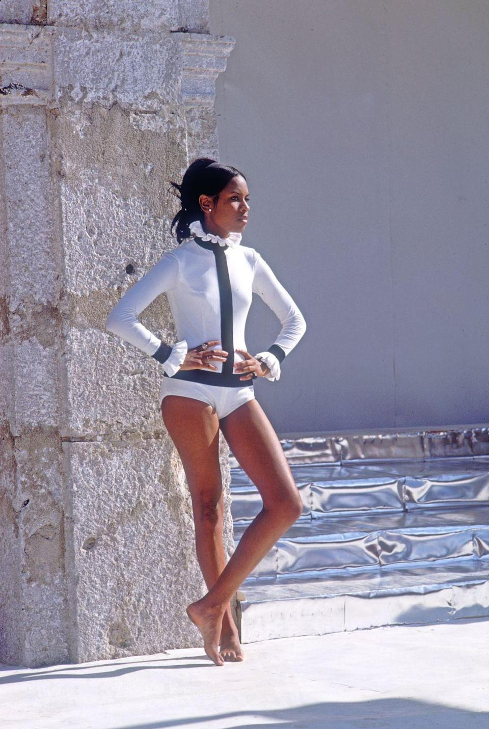 <p>Here's an unexpected frilly-collared bodysuit.</p>