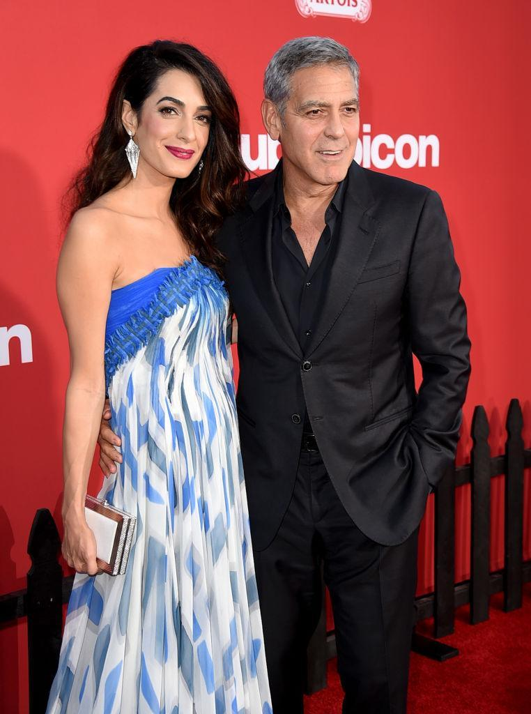 """<p><strong>When: Oct. 22, 2017</strong><br>Amal Clooney accompanied her husband George on the red carpet at the L.A. premiere of his latest film """"Suburbicon"""" on Sunday, but the 39-year-old human rights lawyer also brought along a special guest … (<em>Photo: Getty)</em> </p>"""