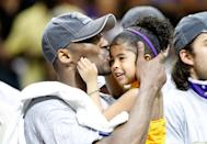 Kobe Bryant #24 of the Los Angeles Lakers kisses his daughter, Gianna, after the Lakers defeated the Orlando Magic 99-86 in Game Five of the 2009 NBA Finals on June 14, 2009 at Amway Arena in Orlando, Florida. (Photo by Ronald Martinez/Getty Images)