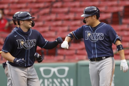 Tampa Bay Rays' Mike Zunino, left, celebrates his two-run home run that also drove in Yoshitomo Tsutsugo, right, during the sixth inning of a baseball game against the Boston Red Sox, Thursday, Aug. 13, 2020, in Boston. (AP Photo/Michael Dwyer)