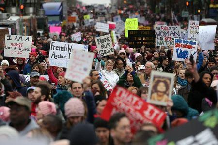 People participate in the Women's March on Washington, following the inauguration of U.S. President Donald Trump, in Washington, D.C., U.S., January 21, 2017. REUTERS/Lucy Nicholson