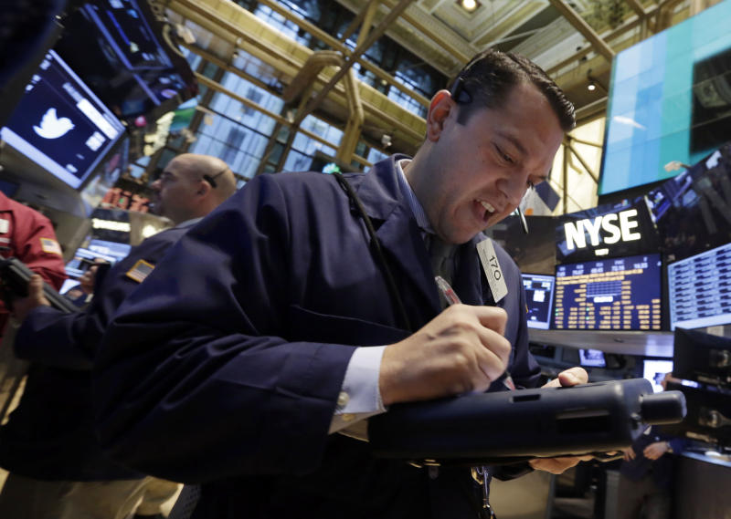Trader Michael Zicchinolfi on the floor of the New York Stock Exchange Friday, Nov. 8, 2013. Stocks edged higher in early Friday trading as investors reacted to an unexpectedly strong October jobs report. (AP Photo/Richard Drew)