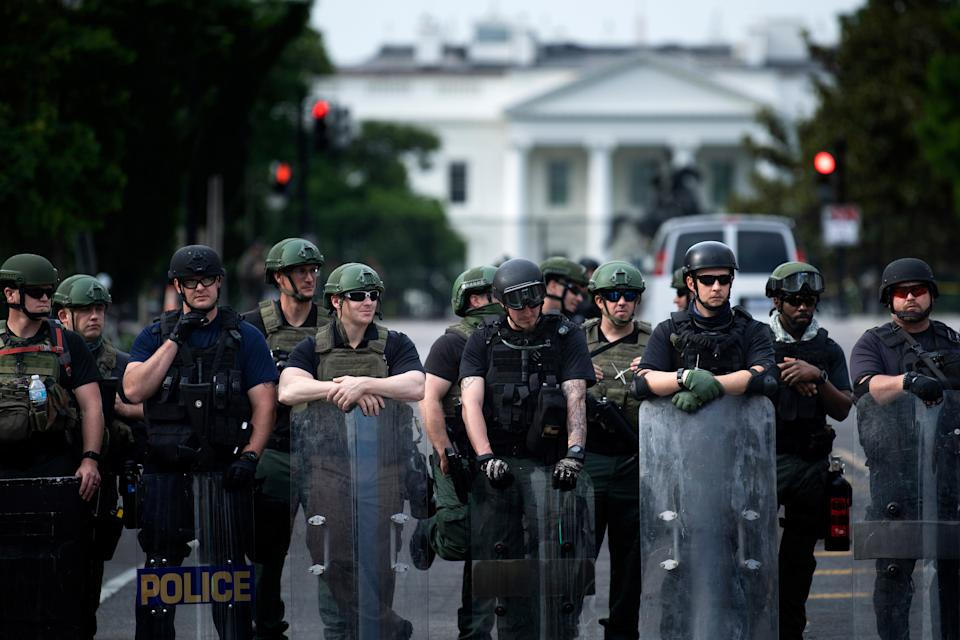 Members of the Federal Bureau of Prisons and other law enforcement personnel block a street near the White House. (Brendan Smialowski/AFP via Getty Images)