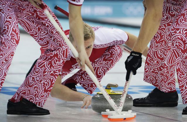 Russia's Petr Dron watches the stone as his team mates sweep the ice during the first day of the men's curling training at the 2014 Winter Olympics, Saturday, Feb. 8, 2014, in Sochi, Russia. (AP Photo/Wong Maye-E)