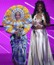 """Doja Cat, left, and SZA accept the award for best collaboration for """"Kiss Me More"""" at the MTV Video Music Awards at Barclays Center on Sunday, Sept. 12, 2021, in New York. (Photo by Charles Sykes/Invision/AP)"""