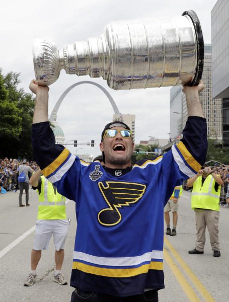 St. Louis Blues left wing Pat Maroon carries the Stanley Cup during the Blues' NHL hockey Stanley Cup victory celebration in St. Louis on Saturday, June 15, 2019. (AP Photo/Darron Cummings)