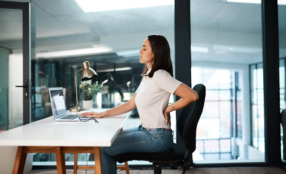 A footrest can help alleviate back pain and improve posture while you sit (Image via Getty Images)