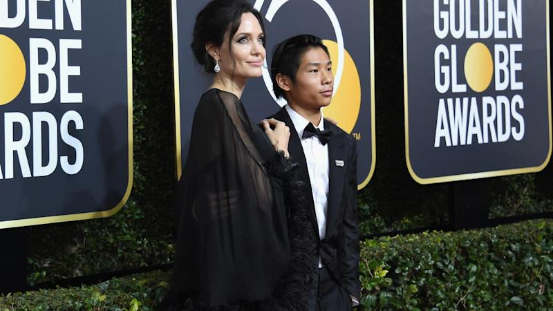 Angelina Jolie hit the red carpet of the 2018 Golden Globes with her 14-year-old son, Pax.