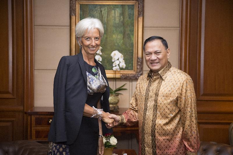In this photograph released by the International Monetary Fund on September 1, 2015, IMF Managing Director Christine Lagarde (L) shakes hands with the Governor of the Bank of Indonesia Agus Martowardojo as she leaves the Bank of Indonesia in Jakarta