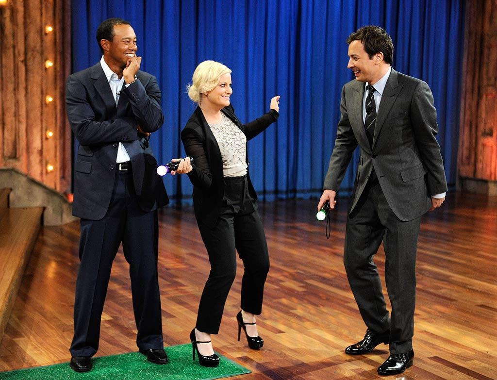 "Amy gave Tiger's new video game a try, but kept attempting to use the game's handheld golf club as a microphone. Stick with your day job, Amy! Kevin Mazur/<a href=""http://www.gettyimages.com/"" target=""new"">GettyImages.com</a> - March 16, 2011"