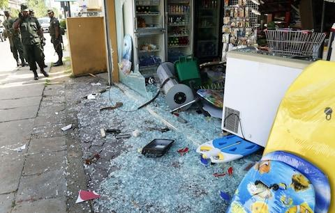 Shops were vandalised in the violence - Credit: REX
