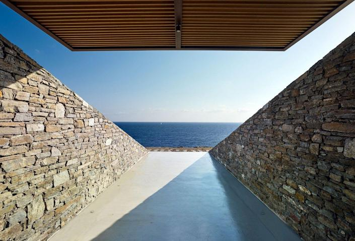 View out into the ocean from inside the modern hillside NCaved House.