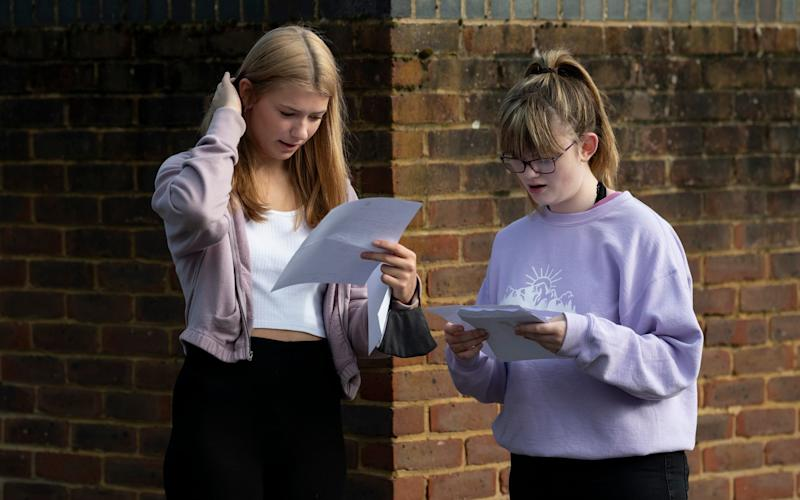 Students open their GCSE results at George Abbott School in Surrey - Christopher Pledger