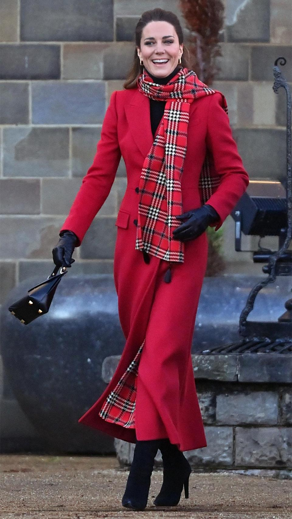 <p>Kate rocked a patterned scarf that complemented her red coat during her December 2020 royal train tour stop in Cardiff, Wales.</p>