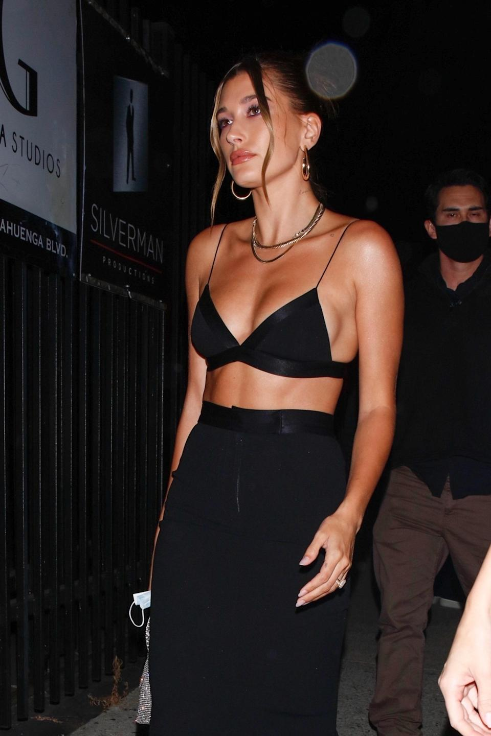 """<h1 class=""""title"""">Hailey Bieber arrives wearing a daring top for Stassie's and Zack Bia's birthday party</h1><cite class=""""credit"""">Photo: Backgrid</cite>"""