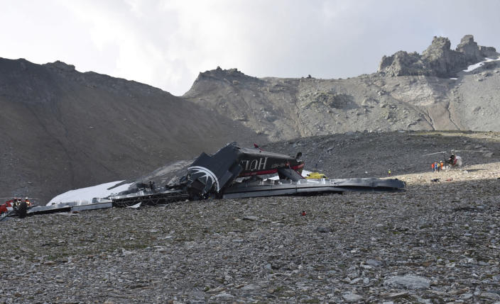 The photo provided by Police Graubuenden shows the wreckage of the old-time propeller plane Ju 52 after it went down went down Saturday Aug, 4 2018 on the Piz Segnas mountain above the Swiss Alpine resort of Flims, striking the mountain's western flank about 2,540 meters (8,330 feet) above sea level. All 20 people on board were killed, police said Sunday, Aug. 5, 2018. (Polizei Graubuenden via AP)