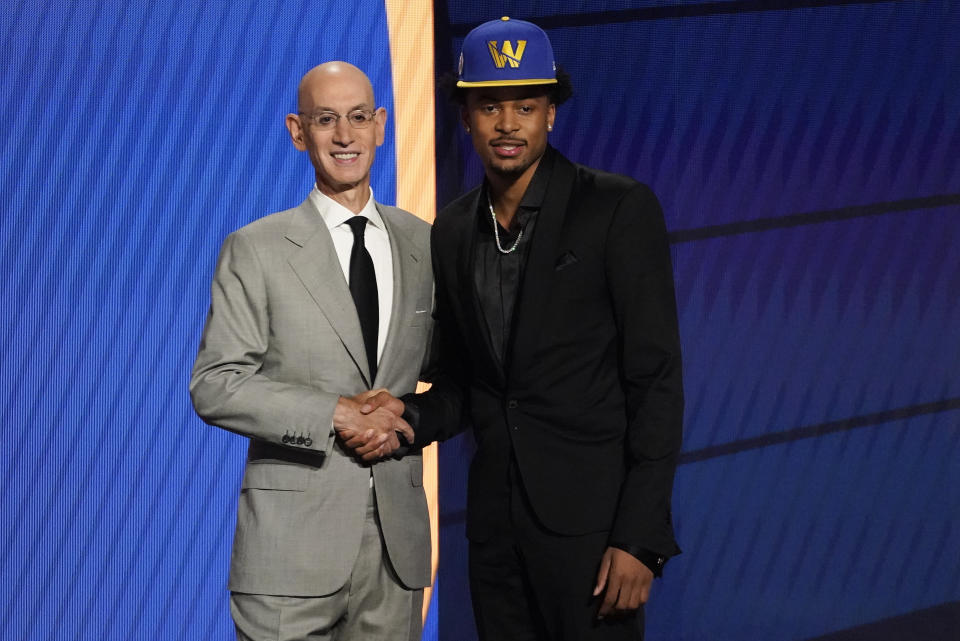 Moses Moody poses for a photo with NBA Commissioner Adam Silver after being selected 14th overall by the Golden State Warriors during the NBA basketball draft, Thursday, July 29, 2021, in New York. - Credit: AP