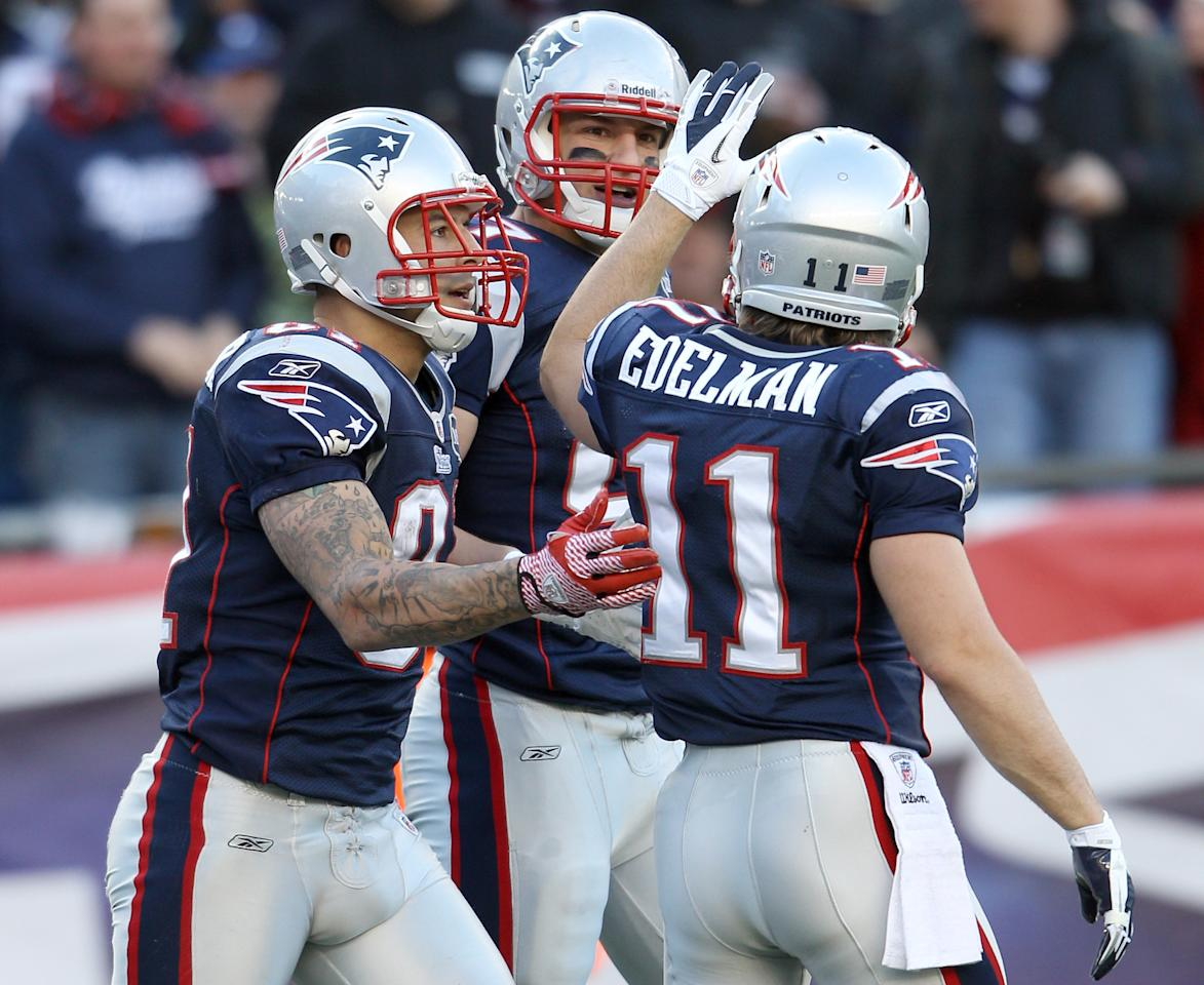 FOXBORO, MA - DECEMBER 04:  Rob Gronkowski #87 of the New England Patriots is congratulated by teammates Aaron Hernandez #81 and Julian Edelman #11 after Gronkowski scored a touchdown in the second half against the Indianapolis Colts on December 4, 2011 at Gillette Stadium in Foxboro, Massachusetts.  (Photo by Elsa/Getty Images)