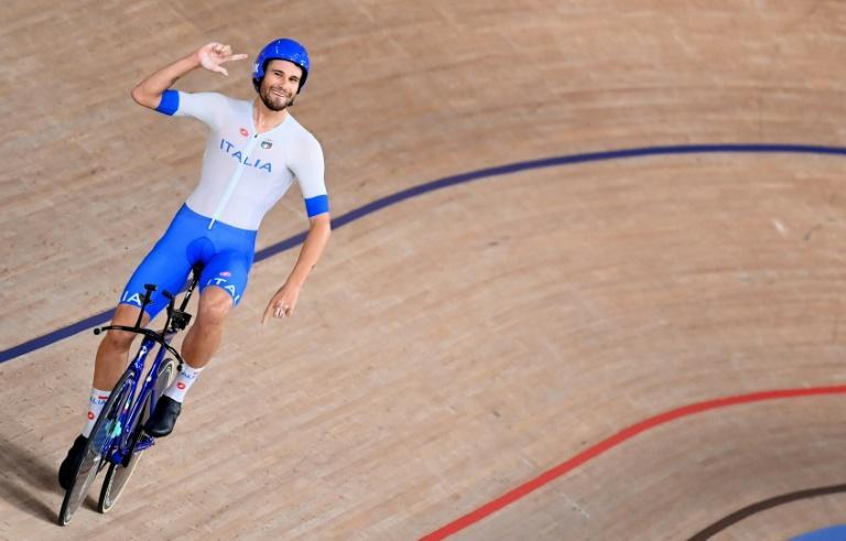 Italy's Filippo Ganna celebrates after leading his team to victory in the men's team pursuit