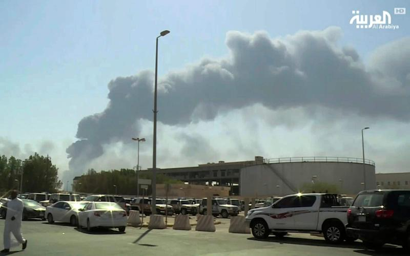 Smoke from a fire at the Abqaiq oil processing facility fills the skyline, in Buqyaq, Saudi Arabia. - Al-Arabiya