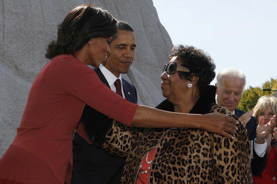 President Barack Obama watches as first lady Michelle Obama thanks singer Aretha Franklin at the dedication ceremony for the Martin Luther King Jr. Memorial in Washington, D.C., in October 2011. (Photo: Larry Downing/Reuters)
