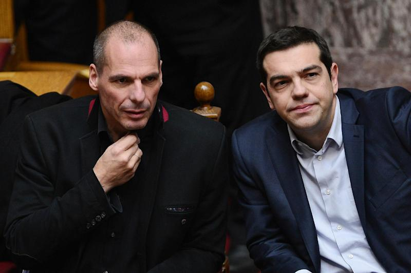 Greek Prime Minister Alexis Tsipras (R) and Finance Minister Yanis Varoufakis, pictured at the Greek parliament in Athens on February 18, 2015 (AFP Photo/Louias Gouliamaki  )