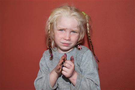 A four-year-old girl, found living with a Roma couple in central Greece, is seen in a handout photo distributed by the Greek police and obtained by Reuters October 18, 2013. REUTERS/Greek Police/Handout