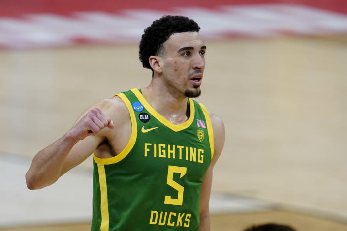 FILE - In this March 22, 2021, file photo, Oregon guard Chris Duarte celebrates the team's win over Iowa in a men's college basketball game in the second round of the NCAA tournament in Indianapolis. Duarte was selected by the Indiana Pacers in the NBA draft Thursday, July 29, 2021. (AP Photo/Paul Sancya, File)