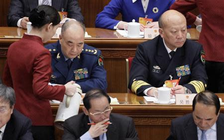 Commander of the Air Force of the Chinese People's Liberation Army (PLA) Xu Qiliang (L) and Commander of the PLA Navy Wu Shengli attend the fourth plenary session of the National People's Congress (NPC) at the Great Hall of the People in Beijing in this March 11, 2010 file photo. REUTERS/Jason Lee/Files